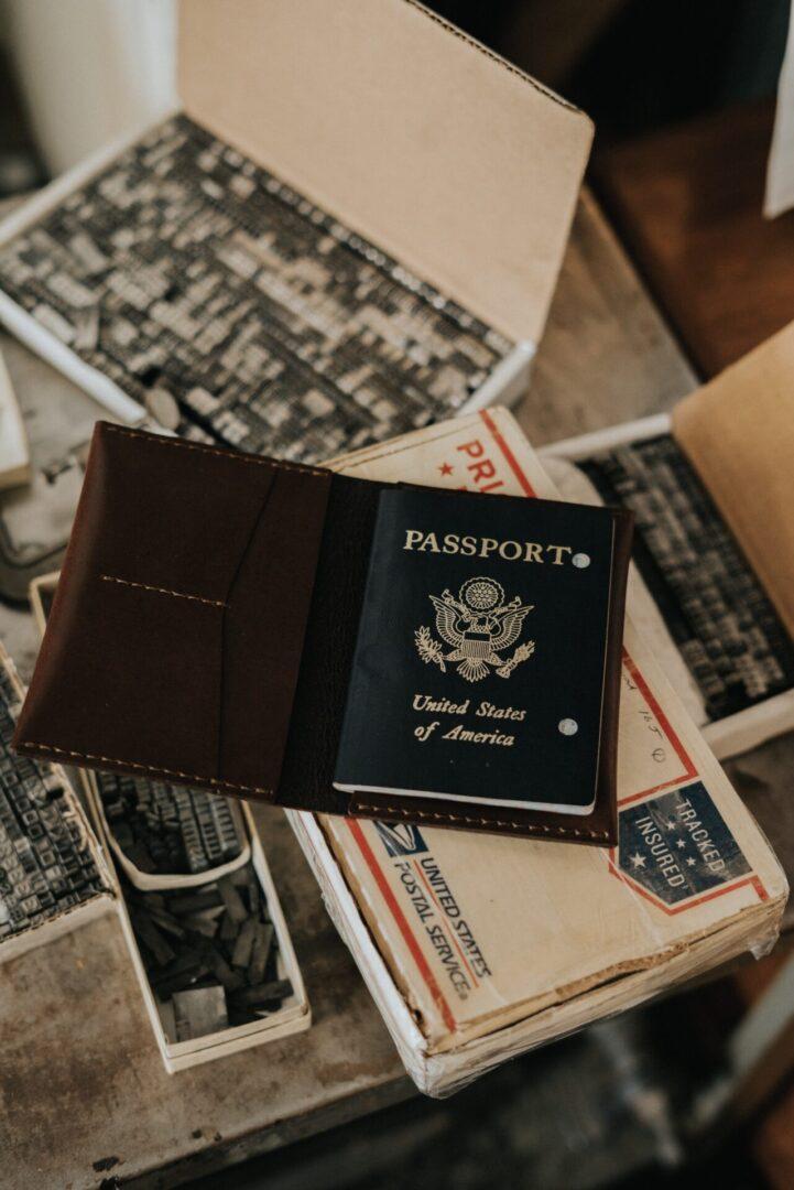 A USA passport on top of metal stamp sets